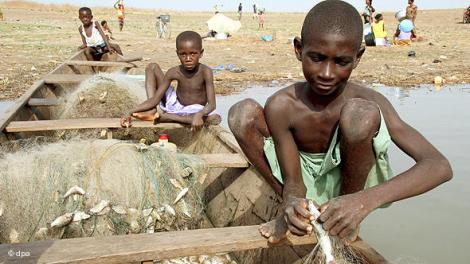 Young boys under forced labor working as fishermen in Ghana having been sold by their impoverished parents