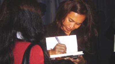 Activist and author Somaly Mam signs a copy of her book for a student at UCF on Monday night.